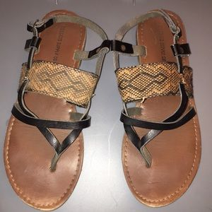 Brown and black sandals